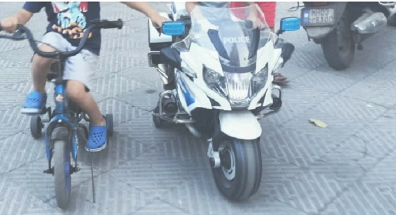 kids police motorcycle, next to kids cycle