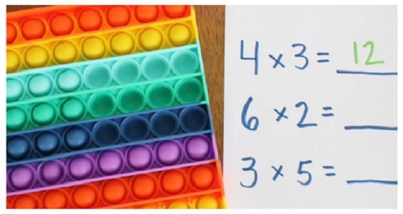 Math game with Push Pop Fidget Toy
