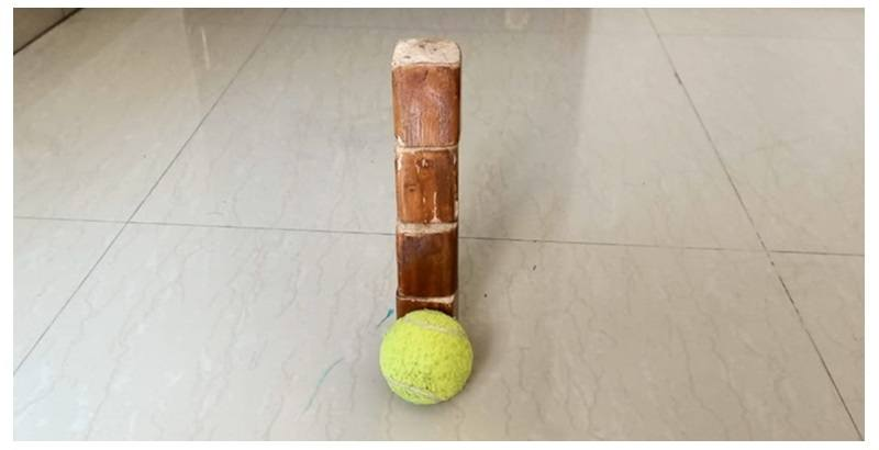 tumble wooden blocks with a tennis ball